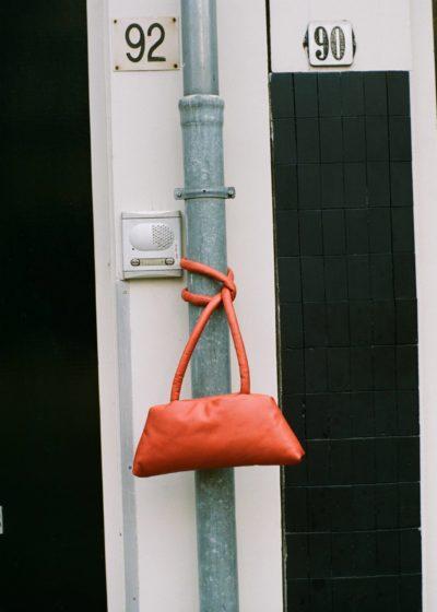 Slim bag in rumba orange leather by KASSL editions