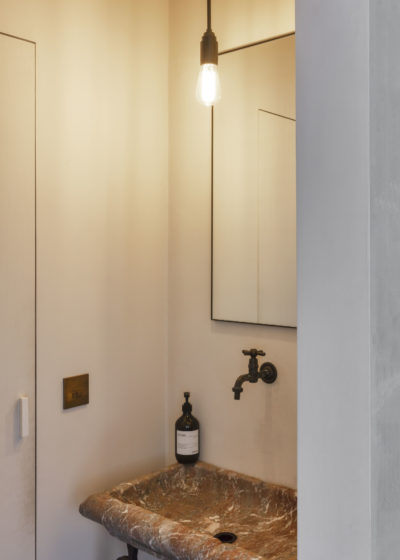 Small 'Edie' mirror in lacquered steel by illus