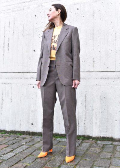 Wool jacket in brown by Auralee