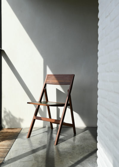 Folding chair with leather seating by Case Goods