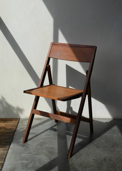 Folding chair by Case Goods