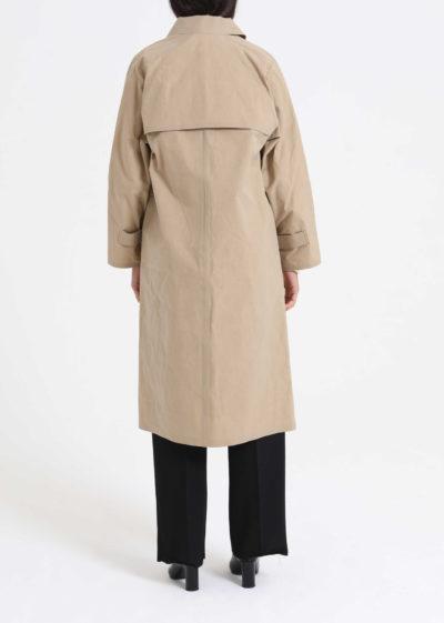 Below the knee wax coat (beige) by KASSL editions